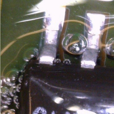 Pic03_large bubbles in conformal coating example